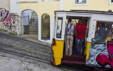 ascensor: LISBON, PORTUGAL - OCTOBER 25 2014: Lavra Funicular going in Lisbon with people in it Editorial