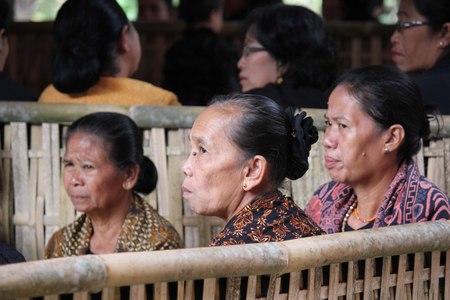 toraja: TANA TORAJA, INDONESIA - JULY 3 2012: Three senior woman sit a funeral ceremony in Tana Toraja