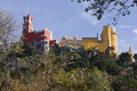 patrimony: View from the Bottom of the hill of the colorful Pena National Palace in Sintra, Portugal