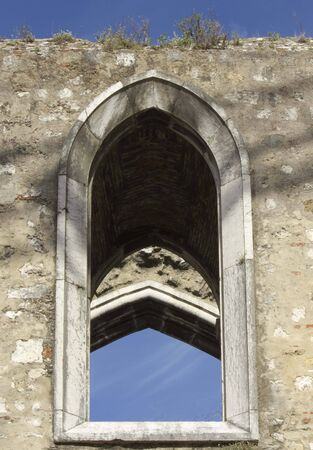 roofless: LISBON, PORTUGAL - OCTOBER 25 2014: Close up detail of an arched window of the Convento do Carmo in Lisbon, damaged by the earthquake