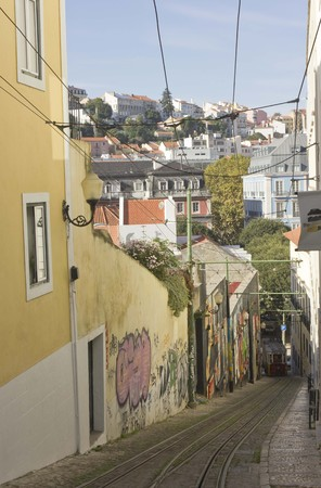 ascensor: LISBON, PORTUGAL - OCTOBER 25 2014: Lavra street in Lisbon with its funicular and view of Lisbon skyline Editorial