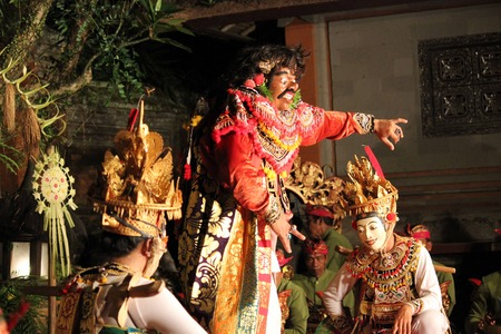 balinese: BALI, INDONESIA - JULY 6 2012: Traditional Balinese dance performance in the public Ubud Palace, with typical Balinese masks on the stage Editorial