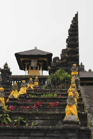 dull: BALI, INDONESIA - JULY 7 2012: Besakih Mother Temple in Bali, sacred temple with all its statues, in a dull day