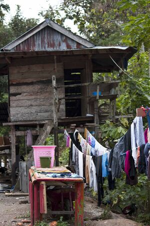 hang out: SULAWESI, INDONESIA - JULY 2 2012: Laundry hang out of an old and poor shed in Indonesia