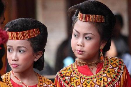 toraja: TANA TORAJA, INDONESIA - JULY 3 2012: Two Torajan girls traditionally dressed at a funeral ceremony in Tana Toraja, Sulawesi Region of Indonesia Editorial