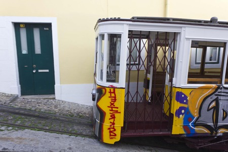 ascensor: LISBON, PORTUGAL - OCTOBER 25 2014: Lavra Funicular going in Lisbon with no people in it