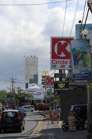 kuta: BALI, INDONESIA - JULY 13 2012: Street along Kuta Beach entrance in Indonesia Editorial