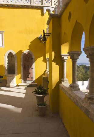 pena: SINTRA, PORTUGAL - OCTOBER 25 2014: Traditional yellow courtyard of Pena National Palace in Sintra, Portugal