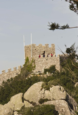 moors: SINTRA, PORTUGAL - OCTOBER 25 2014: Overview from the bottom of the hill of Castle of the Moors, with people on the tower