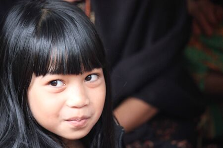 face close up: TANA TORAJA, INDONESIA - JULY 3 2012: Indonesian Child portrait, face close up Editorial