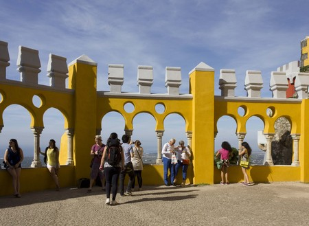 sintra: SINTRA, PORTUGAL - OCTOBER 25 2014: People outside the terrace of Pena National Palace in Sintra, Portugal