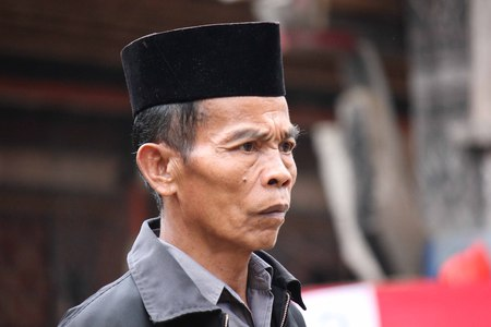 ceremonial clothing: TANA TORAJA, INDONESIA - JULY 3 2012: Portrait of a Torajan man, traditionally dressed for a funeral Editorial