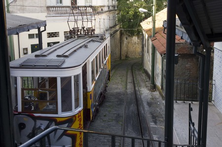 ascensor: LISBON, PORTUGAL - OCTOBER 25 2014: End of the route of Lavra Funicular in Lisbon, all drown with graffiti Editorial