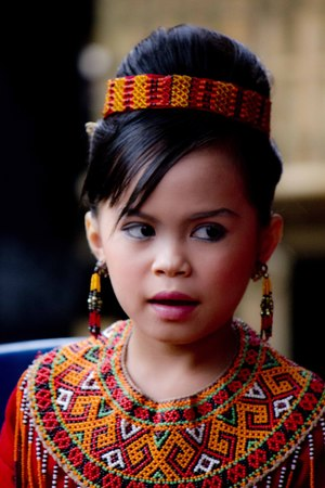 traditional costume: TANA TORAJA, INDONESIA - JULY 3 2012: Portrait of a young Toraja girl in traditional costume at a funeral ceremony Editorial