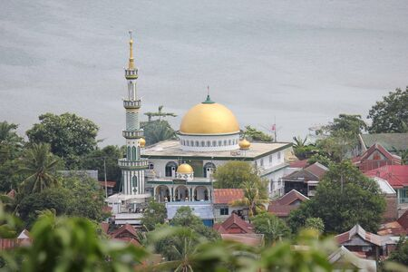 celebes: SULAWESI, INDONESIA - JULY 2 2012: Al Falah places of worship overview from the top of an hill Editorial