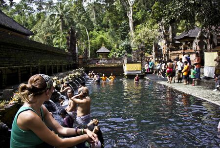 a bathing place: BALI, INDONESIA - JULY 7 2012: People bathing at Sacred Fountains of Tirta Empul in Bali