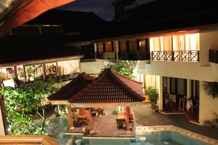 hotel indonesia: BALI, INDONESIA - JULY 12 2012:  Inside the Flora Kuta Hotel in Bali, view of the swimming pool from the room