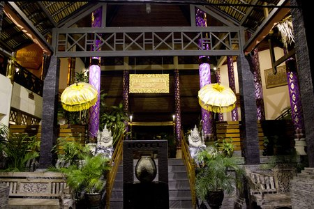 kuta: BALI, INDONESIA - JULY 12 2012: Entrance of the Flora Hotel in Kuta, Bali, with traditional balinese decorations
