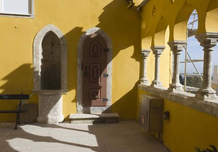 patrimony: SINTRA, PORTUGAL - OCTOBER 25 2014: Traditional yellow courtyard of Pena National Palace in Sintra, Portugal