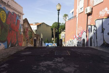 lavra: LISBON, PORTUGAL - OCTOBER 25 2014: Calcada do Lavra street in Lisbon with its graffiti and nobody around