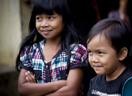toraja: TANA TORAJA, INDONESIA - JULY 3 2012: Portrait of two Indonesian children, brother and sister, smiling Editorial