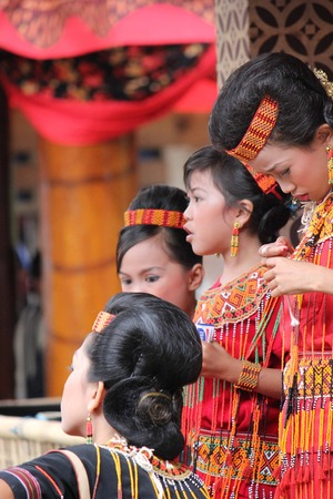toraja: TANA TORAJA, JULY 3 2012: Group of Indonesian girl, from Toraja land, traditional dressed during a funeral ceremony