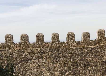 moors: Architectural close up of the walls of Moors Castle in Sintra, Portugal, facing the sky