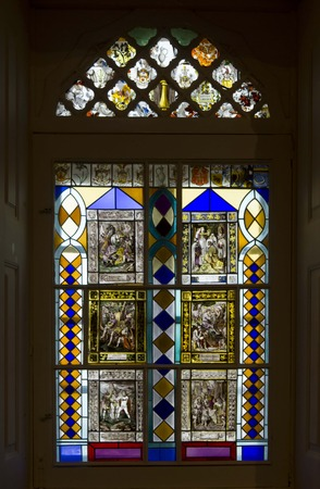 the pena national palace: SINTRA, PORTUGAL - OCTOBER 25 2014: Stained glass window inside Pena National Palace in Sintra, Portugal