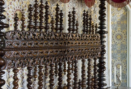 headboard: Close up detail of the decorated headboard of Sintra National Palace in Portugal Editorial