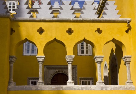 the pena national palace: SINTRA, PORTUGAL - OCTOBER 25 2014: Architectural close up of arch columns in the court of Pena National Palace in Sintra, Portugal