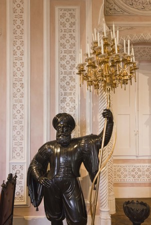 the pena national palace: Statue holding a lamp in the rooms of Pena National Palace in Sintra, Portugal Editorial