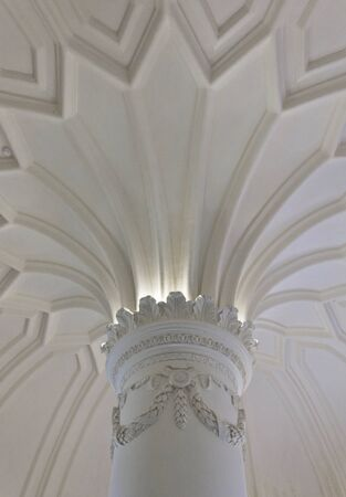 corinthian: Close up of a corinthian capital and decorated ceiling in Pena Palace in Sintra, Portugal