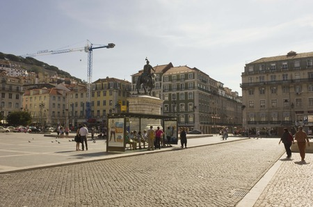 baixa: LISBON, PORTUGAL - OCTOBER 26 2014: Figuera square in Lisbon with its equestrian statue, and people walking around