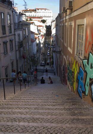 baixa: LISBON, PORTUGAL - OCTOBER 23 2014: Deep slope stairway in Baixa quartier in Lisbon, Portugal