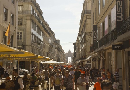 augusta: LISBON, PORTUGAL - OCTOBER 26 2014: Rua Augusta in Lisbon, full of people after the end of the marathon (orange skirts)