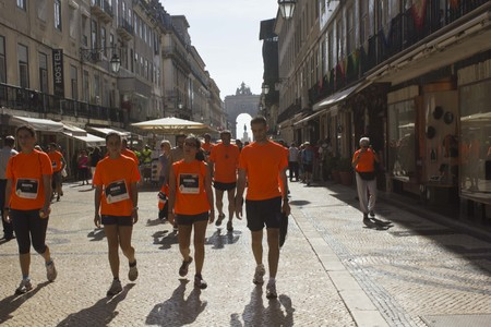 augusta: LISBON, PORTUGAL - OCTOBER 26 2014: Participant walking in Rua Augusta il Lisbon afetr the end of the marathon