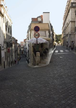 baixa: LISBON, PORTUGAL - OCTOBER 23 2014: Traditional slope street in Baixa quartier in Lisbon, Portugal