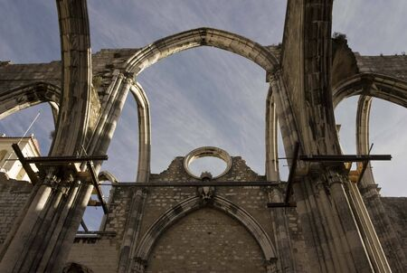 roofless: LISBON, PORTUGAL - OCTOBER 24 2014: Looking up at the damages roof of Carmo Convent in Lisbon, damaged by the eartquake
