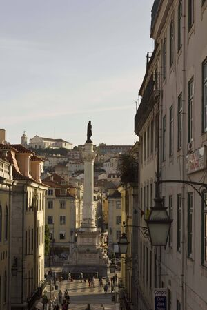 carmo: LISBON, PORTUGAL - OCTOBER 24 2014: Pedro IV column in Rossio square viewed from the top of Calcada do Carmo in Lisbon, Portugal Editorial