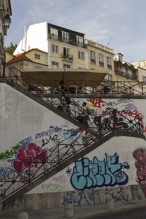 chiado: LISBON, PORTUGAL - OCTOBER 24 2014: The staircase from Rossio Station to Calcada do Duque in Bairro Alto quartier in Lisbon, with people around