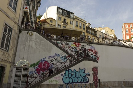 bairro: LISBON, PORTUGAL - OCTOBER 24 2014: The staircase from Rossio Station to Calcada do Duque in Bairro Alto quartier in Lisbon, with people around