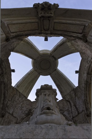 carmo: LISBON, PORTUGAL - OCTOBER 24 2014: Architectural close up of the top of Carmo fountain in Lisbon, facing the sky