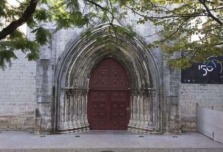 carmo: LISBON, PORTUGAL - OCTOBER 24 2014: External door of Convento do Carmo church in Lisbon, closed