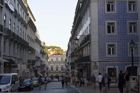 garret: LISBON, PORTUGAL - OCTOBER 23 2014: Corner between Rua Garret and Rua anchieta in Lisbon, with people walking along the street