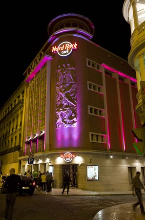 hard rock: LISBON, PORTUGAL - OCTOBER 24 2014: Hard Rock Cafe building at night in Lisbon, with few people around