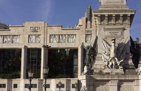 historical building: LISBON, PORTUGAL - OCTOBER 24 2014: Architectural close up of Eden Teatro and column monument In Lisbon restoration square