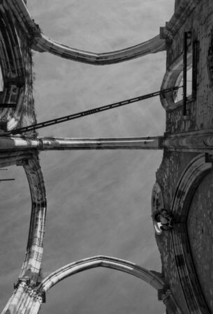 roofless: Looking up at the damaged roof of Carmo Convent in Lisbon, roofless due to the Lison eartquake. Black and white