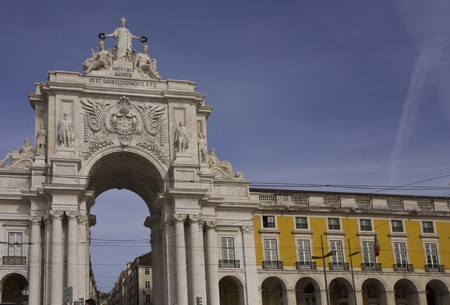augusta: LISBON, PORTUGAL - OCTOBER 24 2014: Architectural close up of Rua Augusta arch and colonnade in Lisbon, Portugal