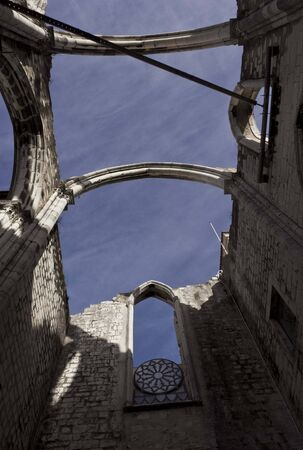 roofless: LISBON, PORTUGAL - OCTOBER 24 2014: Looking up at the roofless Carmo Convent in Lisbon, facing the sky
