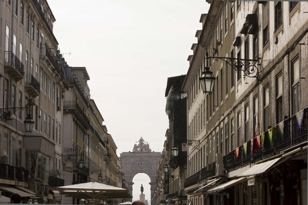 augusta: LISBON, PORTUGAL - OCTOBER 24 2014: Buildings in Rua Augusta in Lisbon, with the triumphal Arch in the background